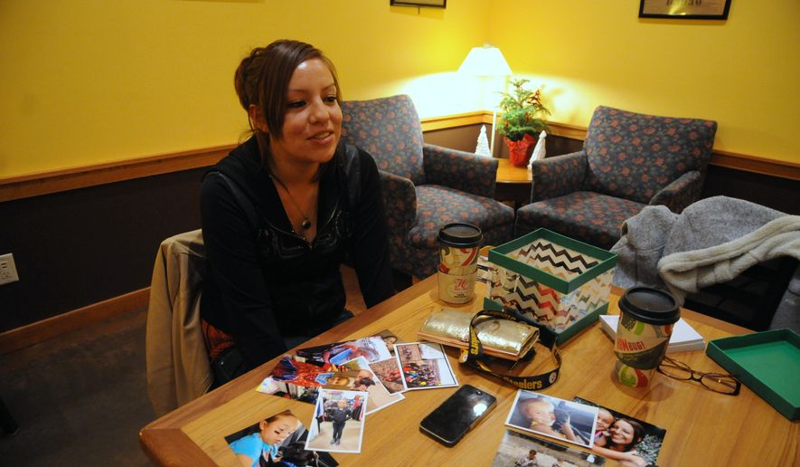 In this Dec. 20, 2014 photo, Danielle Griffith, mother of Jayla Rodriguez, an 8-year-old victim of a fatal dog attack last month on the Pine Ridge Indian Reservation, appears in Rapid City, S.D. Jayla's family is raising funds to create Jayla's Dream, an animal shelter in her name. (AP Photo/James Nord)