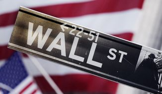 This Aug. 9, 2011, file photo shows a Wall Street street sign near the New York Stock Exchange, in New York. (AP Photo/Mark Lennihan, File)