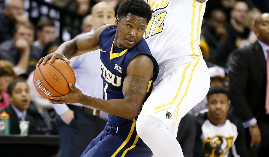 East Tennessee State's Petey McClain, left, tries to moves the ball around VCU's Mo Alie-Cox, right, during the first half of an NCAA college basketball game at the Siegel Center in Richmond, Va., Monday, Dec. 22, 2014.(AP Photo/Richmond Times-Dispatch,Mark Gormus)