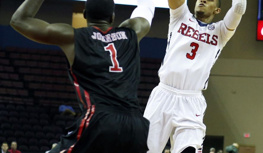 Mississippi guard Terence Smith (3) attempts a shot past the defense of Southeast Missouri State forward Nino Johnson (1) in the first half of an NCAA college basketball game Monday, Dec. 22,  2014, in Southaven, Miss. (AP Photo/Rogelio V. Solis)