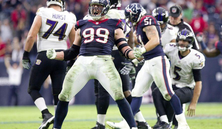 Houston Texans defensive end J.J. Watt celebrates after sacking Baltimore Ravens quarterback Joe Flacco in the fourth quarter of an NFL football game Sunday, Dec. 21, 2014, in Houston. (AP Photo/ The Courier, Jason Fochtman)