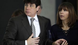 "FILE - In this June 4, 2010 file photo Former Illinois Gov. Rod Blagojevich, left, and his wife Patti join hands as they enter the Federal Court building in Chicago, for the second day of jury selection in his federal corruption trial. Robert Blagojevich the brother of the imprisoned former Illinois Governor, offers fresh details in a new book to back his contention prosecutors used him as a pawn to get his younger sibling on charges he sought to hock President Barack Obama's old U.S. Senate seat. While charges were eventually dropped against him, the Tennessee businessman, says his refusal to turn on his brother made him ""collateral damage"" of an overzealous prosecution that cost his reputation, $1 million in legal bills and a still-unrepaired family split. (AP Photo/M. Spencer Green, File)"