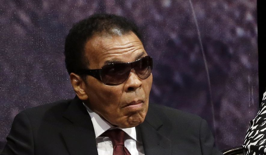 Retired boxing champion Muhammad Ali listens to speakers before receiving the Liberty Medal during a ceremony at the National Constitution Center, Thursday, Sept. 13, 2012, in Philadelphia. The honor is given annually to an individual who displays courage and conviction while striving to secure liberty for people worldwide. (AP Photo/Matt Rourke) **FILE**