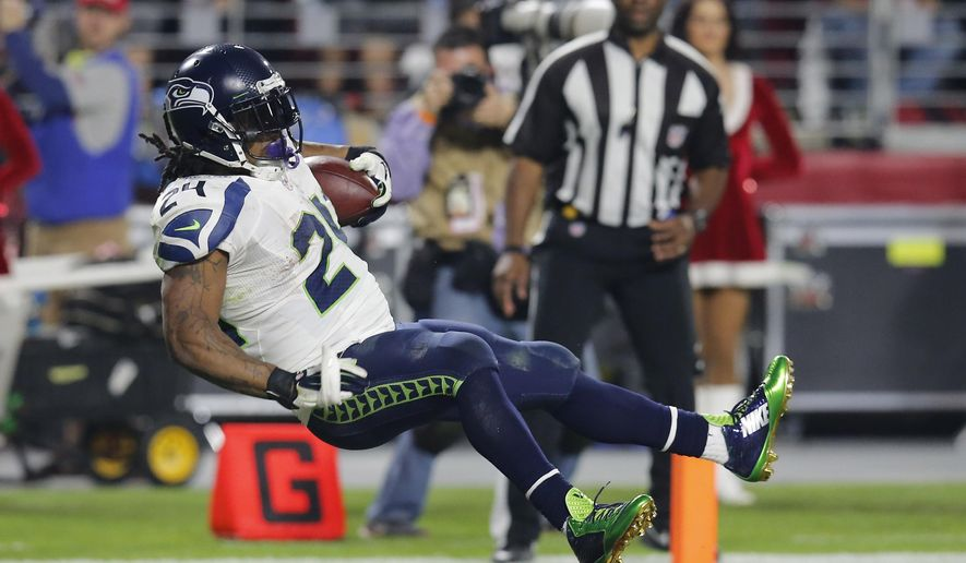 Seattle Seahawks running back Marshawn Lynch (24) leaps into the end zone for a touchdown against the Arizona Cardinals during the second half of an NFL football game, Sunday, Dec. 21, 2014, in Glendale, Ariz. (AP Photo/Rick Scuteri)