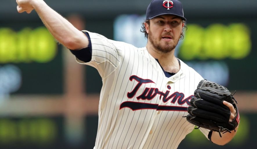 FILE  - This Sept. 24, 2014 file photo shows Minnesota Twins pitcher Phil Hughes throwing against the Arizona Diamondbacks in the first inning of a baseball game in Minneapolis. A person familiar with the deal says the Minnesota Twins and Hughes have agreed to a $58 million, five-year contract that adds $42 million in guaranteed money from 2017-19, on Monday, Dec. 22, 2014. (AP Photo/Jim Mone, file)