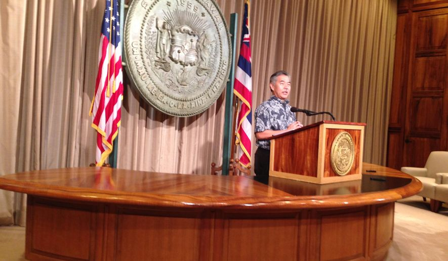 Hawaii Gov. David Ige speaks at a news conference to reveal the first draft of Hawaii's $26 billion state budget for the next two fiscal years in Honolulu, Hawaii on Monday, Dec. 22, 2014. (AP Photo/Cathy Bussewitz)
