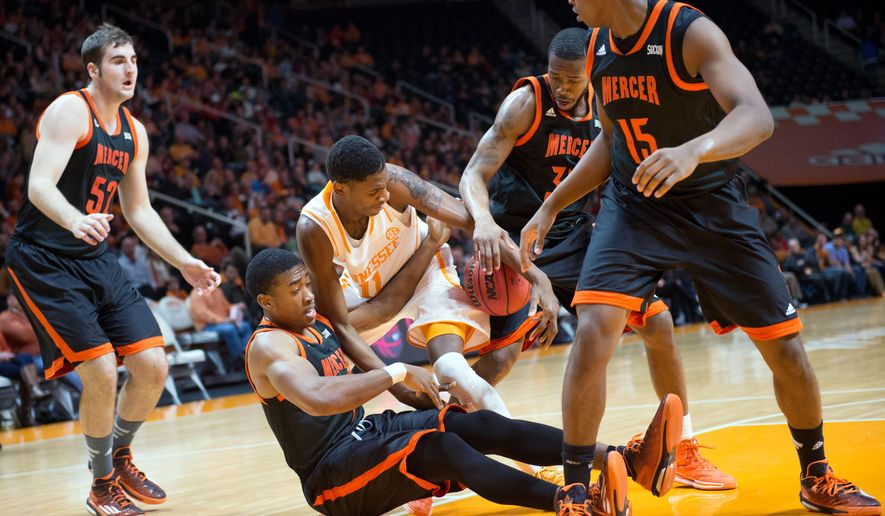 Tennessee's Tariq Owens is surrounded by Mercer's Niklas Ney, Phillip Leonard, Jibri Bryan and Stephon Jelks, from left, during the first half of an NCAA college basketball game in Knoxville, Tenn., on Monday, Dec. 22, 2014. (AP Photo/The Knoxville News Sentinel, Saul Young)