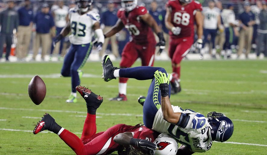 Seattle Seahawks outside linebacker K.J. Wright (50) breaks up a pass intended for Arizona Cardinals running back Marion Grice during the second half of an NFL football game, Sunday, Dec. 21, 2014, in Glendale, Ariz. The  Seahawks won 35-6. (AP Photo/Matt York)