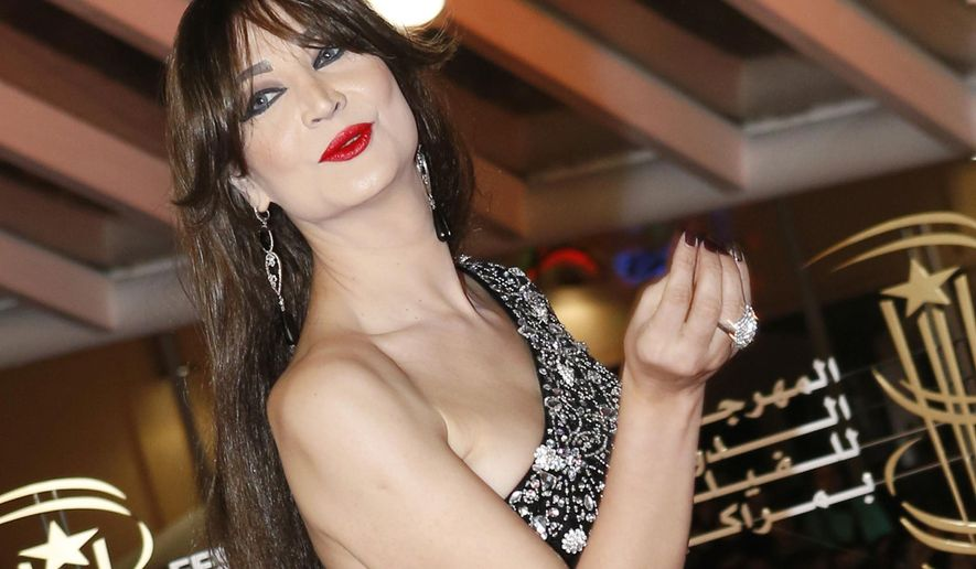 FILE - In this Friday, Dec. 5, 2014, file photo, Moroccan transvestite, actress and dancer Noor poses for photographers as she arrives at the Marrakech International Film Festival in Marrakech, Morocco. In this conservative Muslim country where homosexuality is illegal and punishable by up to three years in jail, a transgender woman like Noor is not only accepted but is a celebrity. Her ability to seemingly transcend the restrictions of her culture speaks both to her star power and to a certain kind of tolerance toward sexual minorities in this North African nation, and even in the wider Middle East. (AP Photo/Abdeljalil Bounhar, File)