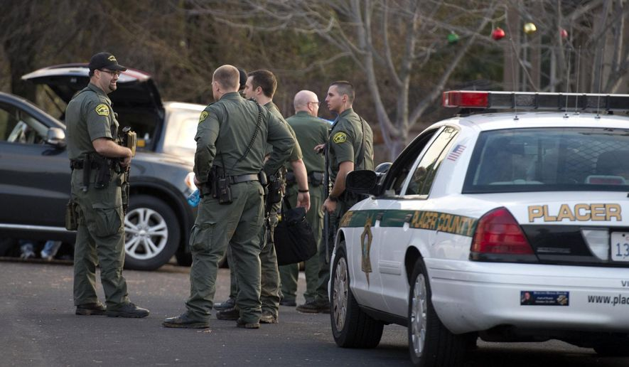 Placer County sheriff's deputies gather near a home on Kemper Oaks Court where a man was shot in his home in Auburn on Sunday, Dec. 21, 2014 in Auburn, Calif. (AP Photo/The Sacramento Bee, Randy Pench)