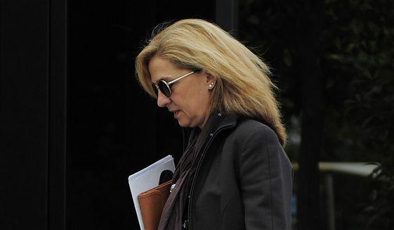 In this April 5, 2013, file photo, Spain's Princess Cristina walks toward her office in Barcelona, Spain.  (AP Photo/Manu Fernandez, File)