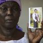 Sorrow: Martha Mark is the mother of Monica Mark, one of the schoolgirls kidnapped by Boko Haram. The girls are likely facing forced labor and sexual assault, according to some who managed to escape. (Associated Press)