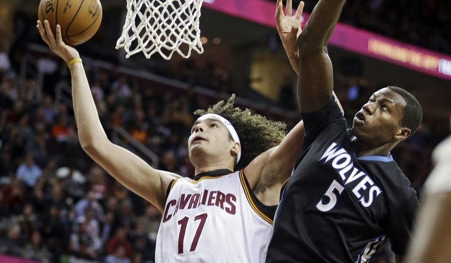Cleveland Cavaliers' Anderson Varejao (17) shoots against Minnesota Timberwolves' Gorgui Dieng (5) during the first quarter of an NBA basketball game Tuesday, Dec. 23, 2014, in Cleveland. (AP Photo/Mark Duncan)