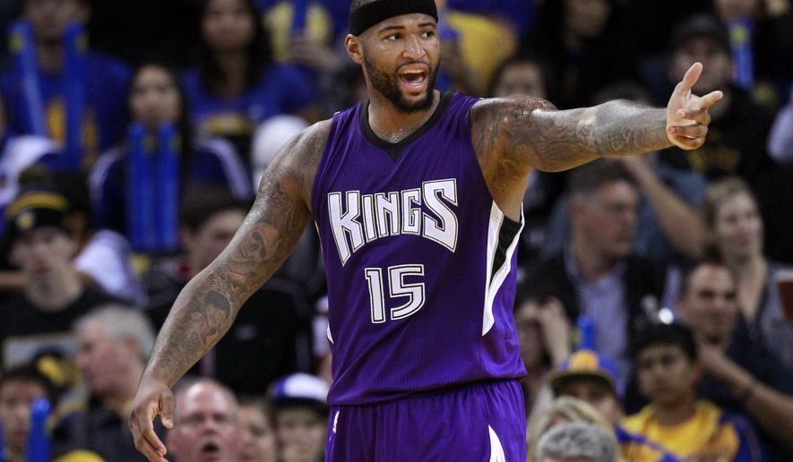 Sacramento Kings' DeMarcus Cousins (15) argues a call against the Golden State Warriors during the second half of an NBA basketball game Monday, Dec. 22, 2014, in Oakland, Calif. Golden State won 128-108.(AP Photo/Marcio Jose Sanchez)