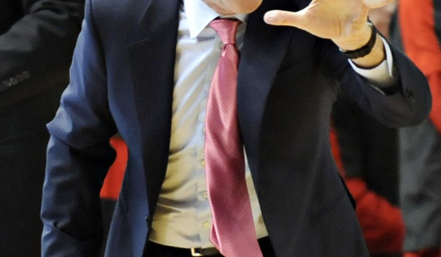 Louisville head coach Rick Pitino motions to his team Saturday, Dec. 20, 2014, during an NCAA college basketball game against Western Kentucky in Bowling Green, Ky. (AP Photo/The Daily News, Miranda Pederson)