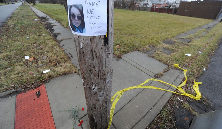 A makeshift memorial for 16-year-old shooting victim Paige Stalker appears near the Grosse Pointe Park border in Detroit on Tuesday, Dec. 23, 2014.  A man repeatedly fired a gun at a car full of suburban teens on Monday, killing Stalker and injuring three others, Detroit police said Tuesday. Police said they were getting conflicting accounts from survivors about why they were in the Detroit neighborhood. The shooting was not considered a random act of violence, Chief James Craig said. (AP Photo/The Detroit News, Max Ortiz)