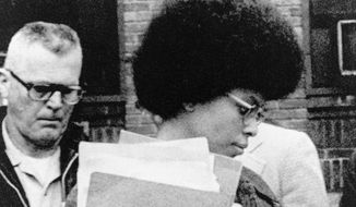 oanne Chesimard, a member of the Black Panther Party and Black Liberation Army, leaves Middlesex County courthouse in New Brunswick, N.J.  Now known as Assata Shakur, she was convicted in 1977 of killing a New Jersey state trooper four years earlier, in a case that drew international attention. She was sentenced to life in prison but escaped. She wound up in Cuba in the 1980s and like other fugitives with political asylum here, once was living so openly in Havana that her number was listed in the phone book. (AP Photo, File)