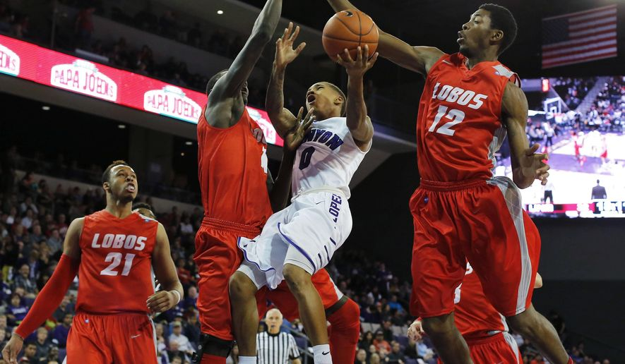 Grand Canyon guard DeWayne Russell (0) drives between New Mexico center Obij Aget (11) and Devon Williams (12) during the second half of an NCAA college basketball game, Tuesday, Dec. 23, 2014, in Phoenix. (AP Photo/Rick Scuteri)