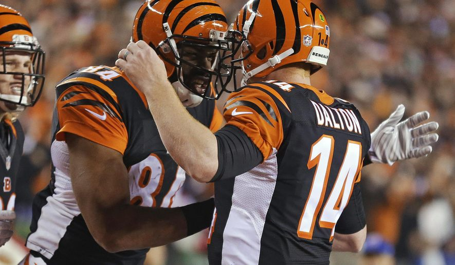 Cincinnati Bengals tight end Jermaine Gresham (84) is congratulated by quarterback Andy Dalton (14) after Gresham's 2-yard touchdown reception during the first half of an NFL football game against the Denver Broncos on