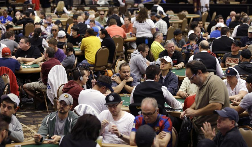 FILE-This July 5, 2014 file photo players compete on the first day of the World Series of Poker main event in Las Vegas. World Series of Poker organizers say the 49-day tournament returns to the Rio All-Suite Hotel & Casino in Las Vegas May 27, 2015, to July 14, 2015. Organizers announced the dates Tuesday, Dec. 23, 2014 and a new event dubbed the Colossus. Organizers say the new no-limit Texas Hold 'Em event will have a $565 buy-in and $5 million prize pool with organizers expecting more than 13,000 entries. (AP Photo/John Locher, File)