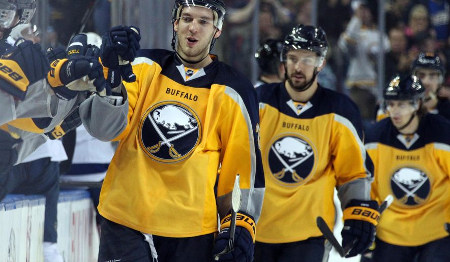 FILE - In this Dec. 2, 2014, file photo, Buffalo Sabres' Zemgus Girgensons (28), of Latvia, is congratulate at the bench after scoring during third period goal of an NHL hockey game against the Tampa Bay Lightning in Buffalo, N.Y. Girgensons is both honored and a little embarrassed to have much of his native Latvia helping him run away with the NHL All-Star Game fan vote. The second-year forward had nearly doubled his closest rival, with about 80 percent of his support coming from home country.  (AP Photo/Jen Fuller, File)