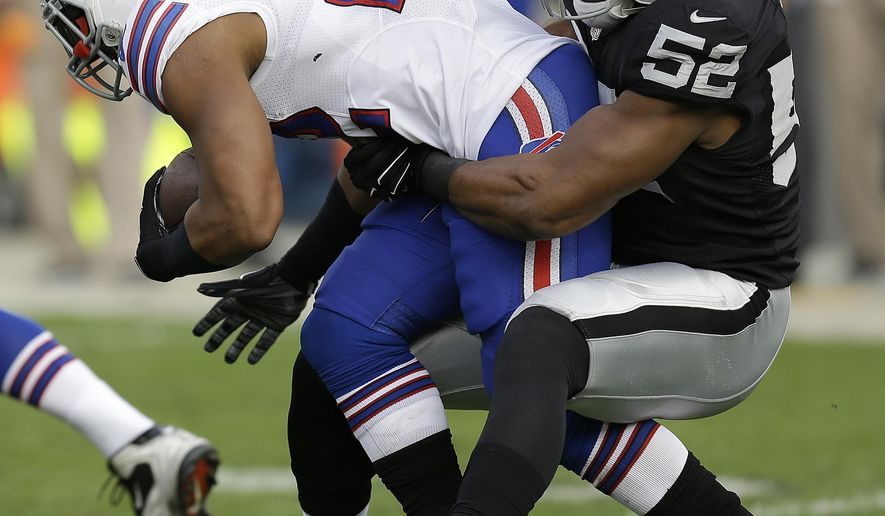Oakland Raiders outside linebacker Khalil Mack (52) tackles Buffalo Bills running back Fred Jackson during the first quarter of an NFL football game in Oakland, Calif., Sunday, Dec. 21, 2014. (AP Photo/Ben Margot)