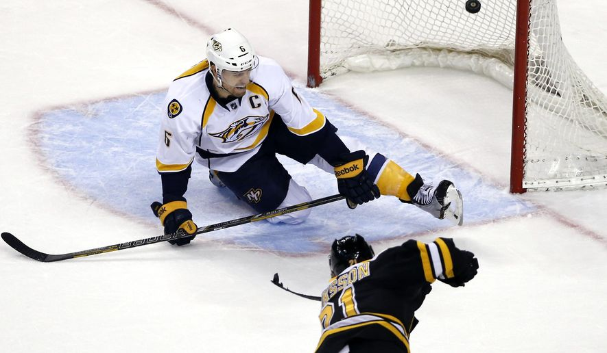 Boston Bruins left wing Loui Eriksson (21) scores an empty net goal as Nashville Predators defenseman Shea Weber (6) tries to defend in the third period of an NHL hockey game in Boston, Tuesday, Dec. 23, 2014. The Bruins won 5-3. (AP Photo/Elise Amendola)