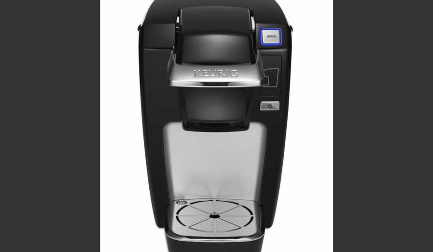 This undated product image from Keurig and released by the Consumer Product Safety Commission shows the Keurig Mini Plus coffee brewer. Keurig is recalling more than 7 million of the single-serve coffee brewing machines after reports that a number of them had spewed hot liquids and injured dozens of users, the company said Tuesday, Dec. 23, 2014. (AP Photo/Keurig via the Consumer Product Safety Commission)