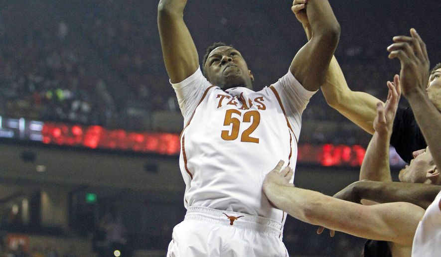 Texas forward Myles Turner (52) get the rebound against Stanford during the first half of an NCAA college basketball game, Tuesday, Dec. 23, 2014, in Austin, Texas. (AP Photo/Michael Thomas)