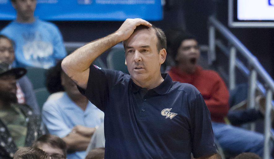 George Washington coach Mike Lonergan watches his team play Colorado in the first half of an NCAA college basketball game at the Diamond Head Classic on Tuesday, Dec. 23, 2014, in Honolulu. (AP Photo /Eugene Tanner)