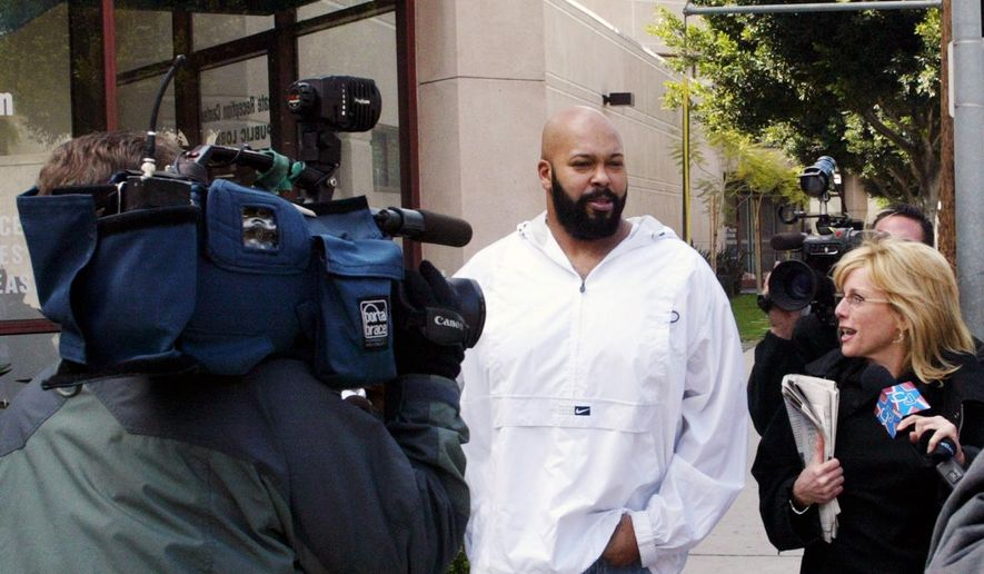"""** FILE ** In this Feb. 26, 2003 file photo, rap music mogul Marion """"Suge"""" Knight, walks out of the Los Angeles County jail in Los Angeles. Knight appeared in a Los Angeles courtroom on Tuesday, Dec. 23, 2014, and was ordered to return to court on Jan. 27, 2015, for the next hearing in a felony robbery case filed after a celebrity photographer reported that he stole her camera in September. (AP Photo/Damian Dovarganes, File)"""