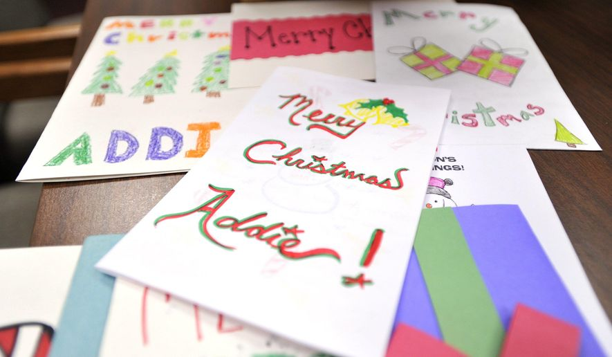 In this Dec. 22, 2014 photo, a selection of Christmas cards are displayed at Mount Nittany Middle School in State College, Pa., meant for 6-year-old Addie Fausett, a terminally ill child in Utah. eighth-grader Ashley Wolynec  spearheaded a school effort to make Christmas cards for Addie, who suffers from a terminal illness that causes cerebral atrophy.  Doctors do not expect her to live another year. (AP Photo/Centre Daily Times, Christopher Weddle)