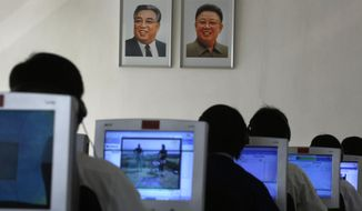 In this Thursday, Sept. 20, 2012, file photo, North Korean students use computers in a classroom with portraits of the country's later leaders Kim Il-sung, left, and his son Kim Jong-il hanging on the wall at the Kim Chaek University of Technology in Pyongyang, North Korea. (AP Photo/Vincent Yu, File)