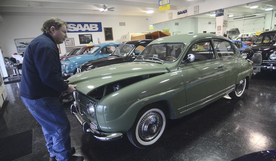 In this undated photo, Tom Donney pops the trunk of his Saab Monte Carlo in his showroom, in Fort Dodge, Iowa. Donney loaned the car to Jerry Seinfeld for a shoot, in Portland, Ore. (AP Photo/The Messenger, Jesse Major)