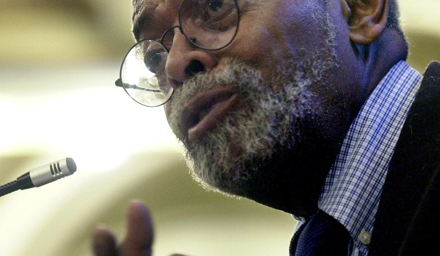 FILE - This Oct. 2, 2002, file photo shows Amiri Baraka, New Jersey's poet laureate during a  ceremony at the Newark Public Library in Newark, N.J. Baraka, a Beat poet, black nationalist and Marxist revolutionary known for his blues-based, fist-shaking manifestos, died, Thursday, Jan. 9, 2014, at Newark Beth Israel Medical Center in Newark, N.J., at age 79. (AP Photo/Mike Derer, File)