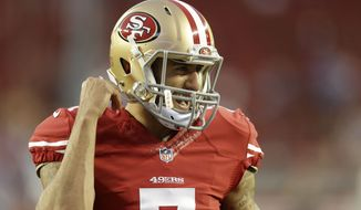 San Francisco 49ers quarterback Colin Kaepernick (7) before an NFL football game against the San Diego Chargers in Santa Clara, Calif., Saturday, Dec. 20, 2014. (AP Photo/Ben Margot)