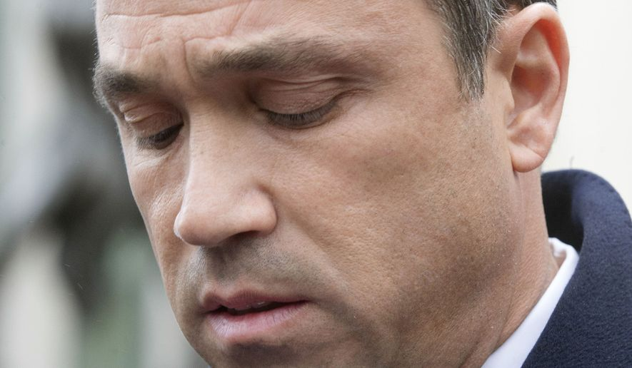 Rep. Michael Grimm speaks to the media outside Federal court in Brooklyn after pleading guilty to a federal tax evasion charge rather than go to trial, Tuesday, Dec. 23, 2014, in New York. Grimm had been set to go to trial in February on charges of evading taxes by hiding more than $1 million in sales and wages while running a Manhattan health-food restaurant. (AP Photo/John Minchillo)