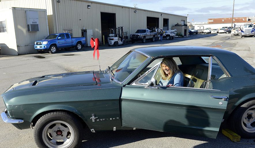 This Dec. 22, 2014 photo shows Lynda Alsip sitting inside her 1967 Ford Mustang at California Towing in Salinas, Calif. The vehicle, Alsip's first car, was stolen from her 28 years ago and was recently recovered by the California Highway Patrol. (AP Photo/Monterey Herald, David Royal)