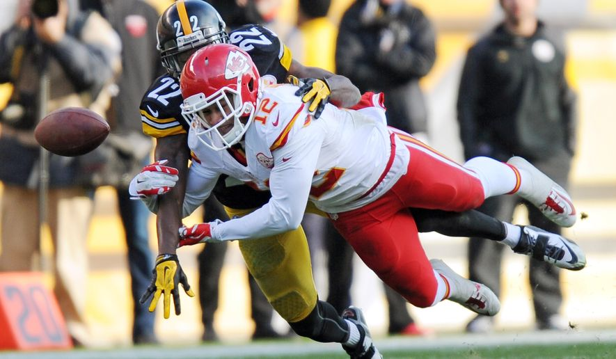 Pittsburgh Steelers cornerback William Gay (22) breaks up a pass intended for Kansas City Chiefs wide receiver Albert Wilson (12)  during the second half of an NFL football game in Pittsburgh, Sunday, Dec. 21, 2014. (AP Photo/Don Wright)