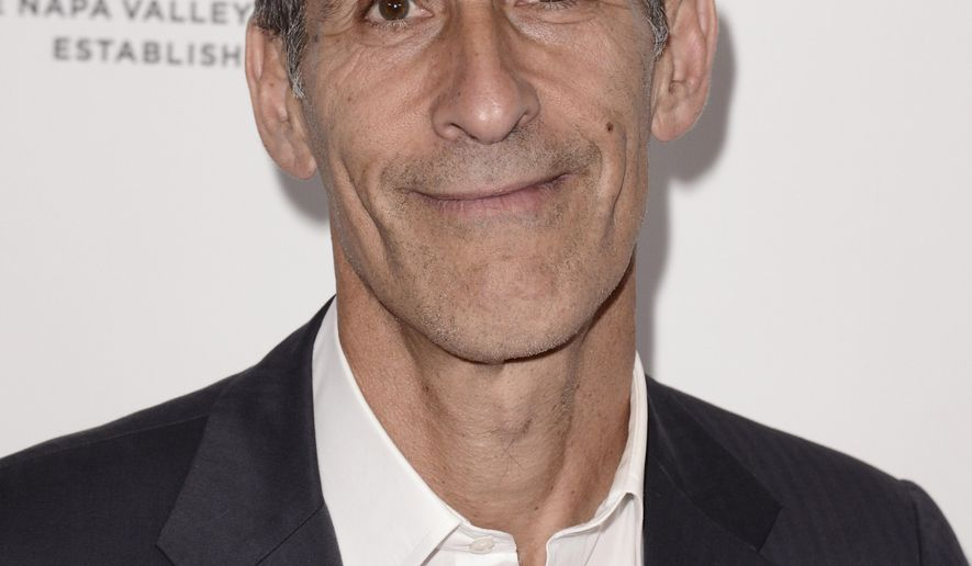 """FILE - In this April 25, 2014 file photo, Michael Lynton, chairman and CEO, Sony Pictures Entertainment, arrives at the 19th annual """"Taste For A Cure"""" at the Beverly Wilshire Hotel, in Beverly Hills, Calif. Sony Pictures Entertainment issued the following statement Tuesday, Dec. 23, 2014, on releasing """"The Interview"""" in a limited number of US movie theaters on Thursday: """"We have never given up on releasing 'The Interview' and we're excited our movie will be in a number of theaters on Christmas Day,"""" said Lynton. (Photo by Dan Steinberg/Invision/AP, File)"""