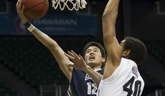 George Washington forward Yuta Watanabe (12) drives to the basket while being defended by Colorado forward Josh Scott (40) in the first half of an NCAA college basketball game at the Diamond Head Classic on Tuesday, Dec. 23, 2014, in Honolulu.  (AP Photo/Eugene Tanner)