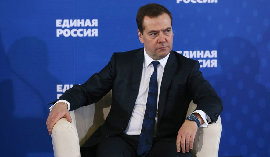 "Russian Prime Minister Dmitry Medvedev  listens during a meeting with senior ruling United Russia Party officials in Moscow, Russia on Tuesday, Dec. 23, 2014. Medvedev has warned that the country faces a risk of a ""deep recession"" if the government ditches its spending plans. (AP Photo/RIA Novosti, Yekaterina Shtukina, Government Press service)"