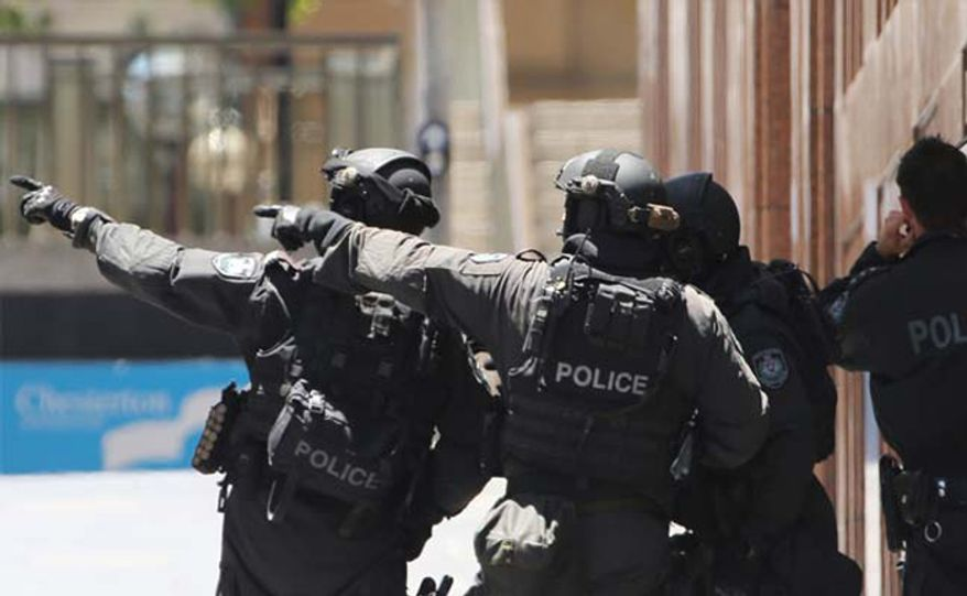 Police officers respond to a hostage situation in Sydney, Australia, Dec. 17, 2014. (Associated Press) ** FILE **