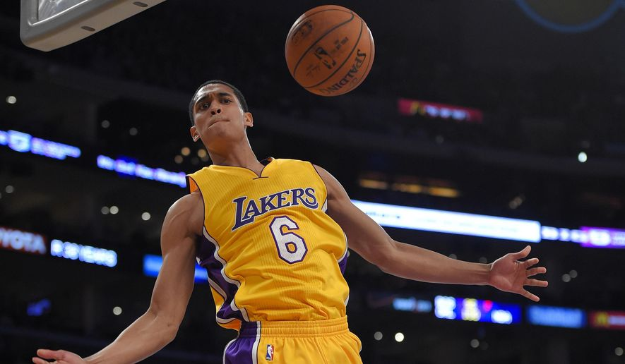 Los Angeles Lakers guard Jordan Clarkson dunks during the first half of an NBA basketball game against the Golden State Warriors, Tuesday, Dec. 23, 2014, in Los Angeles. (AP Photo/Mark J. Terrill)