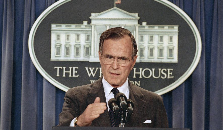 FILE - In this Thursday, May 11, 1989, file photo, President George H.W. Bush briefs reporters at the White House in Washington. Former President George H.W. Bush was taken to a Houston hospital after experiencing a shortness of breath on Tuesday, Dec. 23, 2014. (AP Photo/Doug Mills, File)
