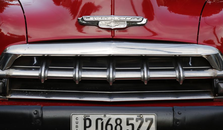 The detail of the front end of a recently painted 1952 Chevrolet sits parked in Havana, Cuba, Sunday, Dec. 21, 2014. U.S. car sales have been banned in Cuba since 1959, forcing Cubans to patch together Fords, Chevrolets and Chryslers that date back to before Fidel Castro's revolution. (AP Photo/Desmond Boylan)