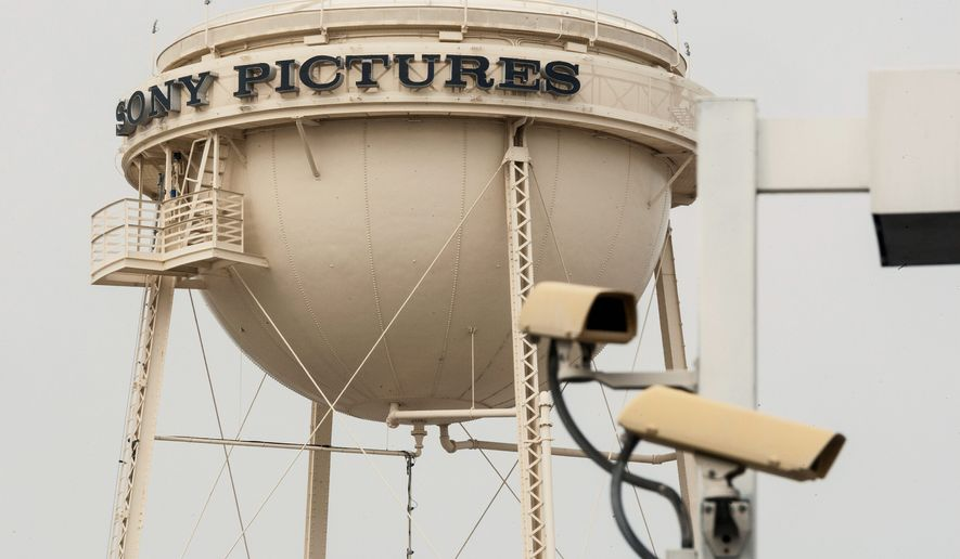 """Sony Pictures is trying to chart the right course through political and public-opinion minefields after a hacking attempt to prevent its release of """"The Interview."""" (Associated Press)"""