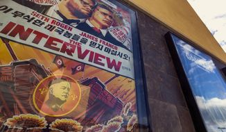 "This Wed., Dec. 17, 2014, photo shows a movie poster for the movie ""The Interview"" on display outside the AMC Glendora 12 movie theater, in Glendora, Calif. (AP Photo/Damian Dovarganes, File)"