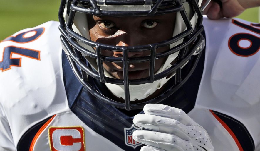 FILE  - In this Dec. 14, 2014, file photo, Denver Broncos defensive end DeMarcus Ware prepares for an NFL football game against the San Diego Chargers in San Diego. Ware considers himself a mixed martial artist on the football field, and for good reason. He's part of a growing number of NFL defensive ends who have adopted the moves of MMA to help them outmaneuver 330-pound tackles.  (AP Photo/Lenny Ignelzi, File)