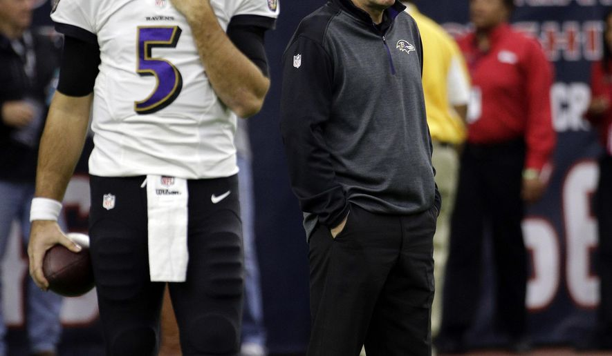 Baltimore Ravens quarterback Joe Flacco (5) warms up as Ravens Offensive Coordinator and former Houston Texans head coach Gary Kubiak, right, looks on before an NFL football game against the Texans Sunday, Dec. 21, 2014, in Houston. (AP Photo/David J. Phillip)